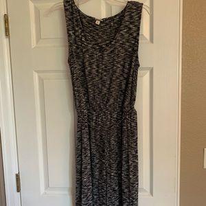 Black/white knee length v-neck dress.